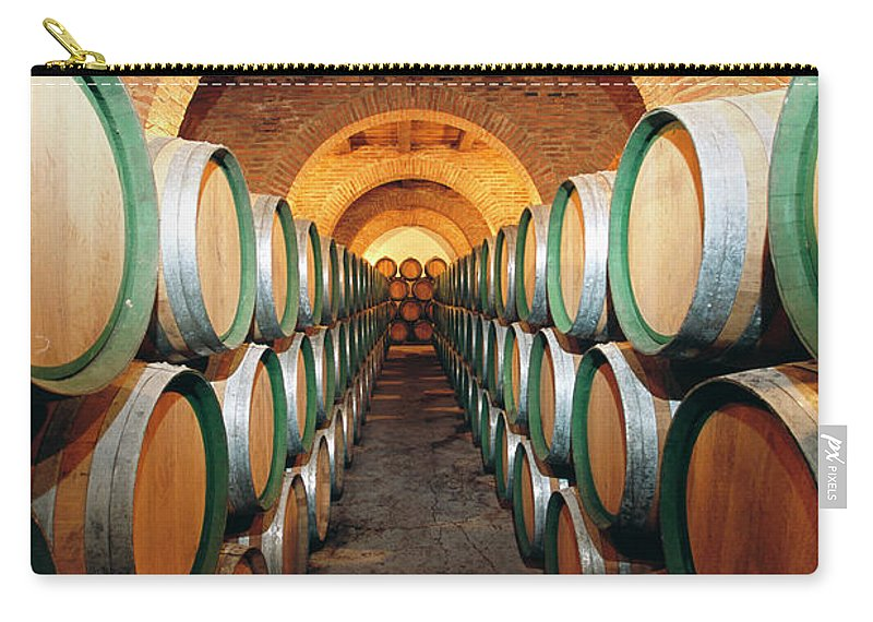 Working Carry-all Pouch featuring the photograph Wine Barrels In Cellar, Spain by Johner Images