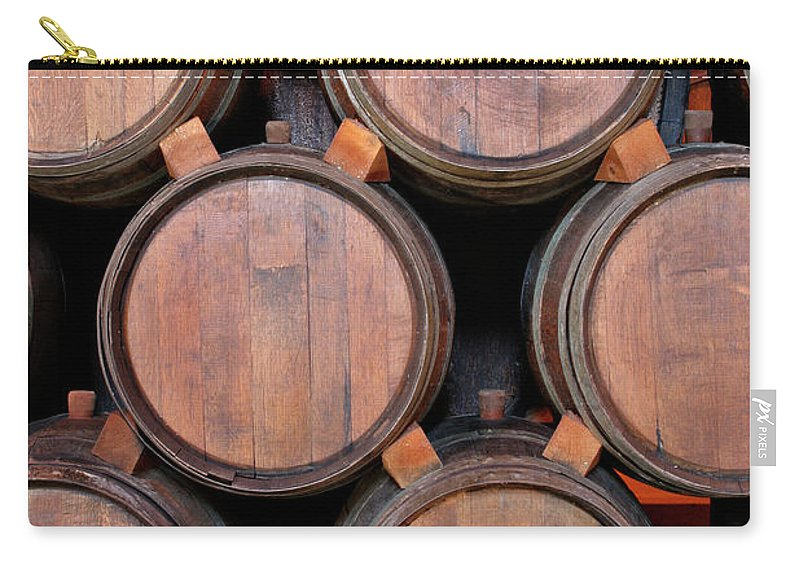 Fermenting Carry-all Pouch featuring the photograph Wine Barrels Stacked Inside Winery by Yinyang