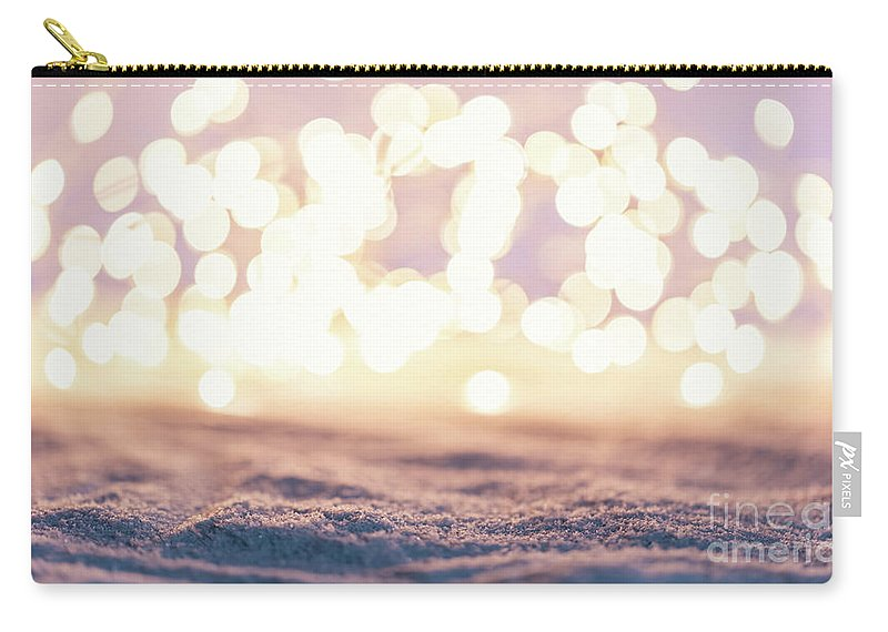 Winter Carry-all Pouch featuring the photograph Winter Background With Snow And Fairy Lights. by Michal Bednarek