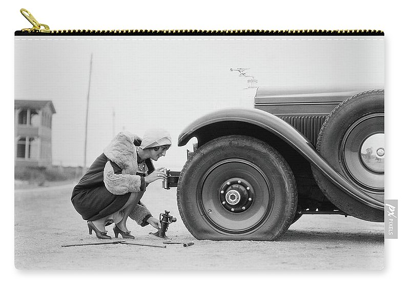 People Carry-all Pouch featuring the photograph Woman Changing Flat Tire On Car by H. Armstrong Roberts