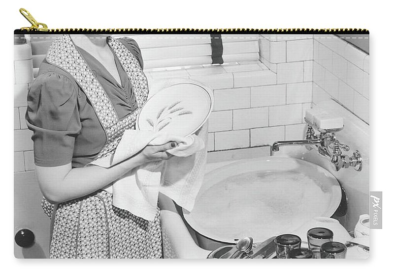 Three Quarter Length Carry-all Pouch featuring the photograph Woman Drying Dishes At Kitchen Sink by George Marks