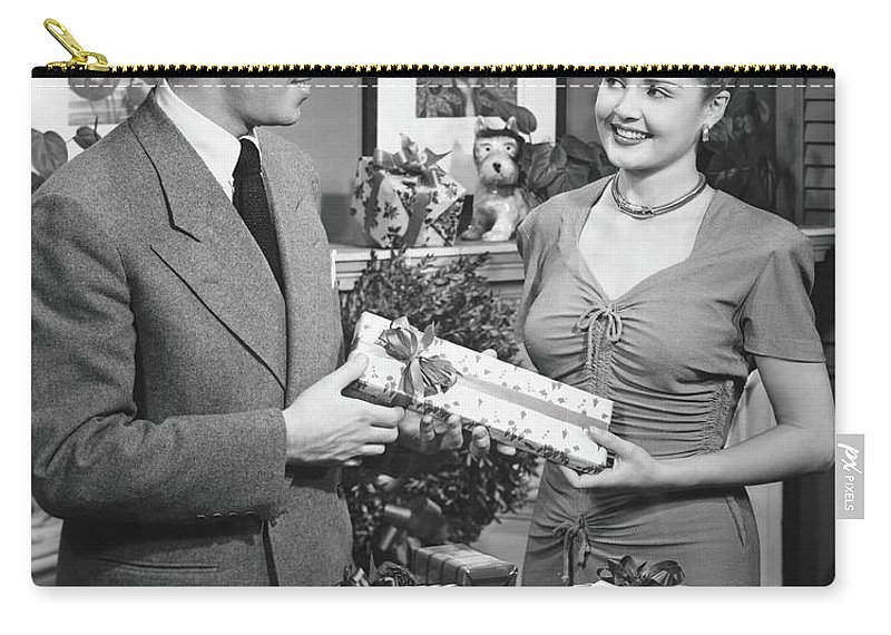 Heterosexual Couple Carry-all Pouch featuring the photograph Woman Giving Gift To Man, B&w by George Marks