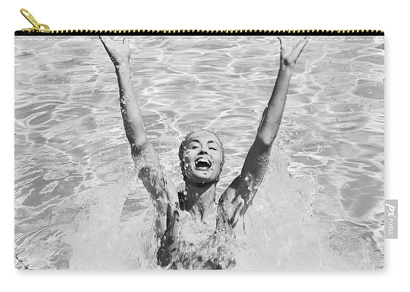 Human Arm Carry-all Pouch featuring the photograph Woman Having Fun In Swimming Pool by Tom Kelley Archive