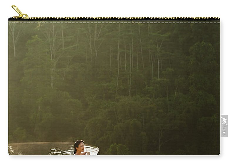 Tropical Rainforest Carry-all Pouch featuring the photograph Woman In Infinity Pool At Sunrise. Bali by Matthew Wakem