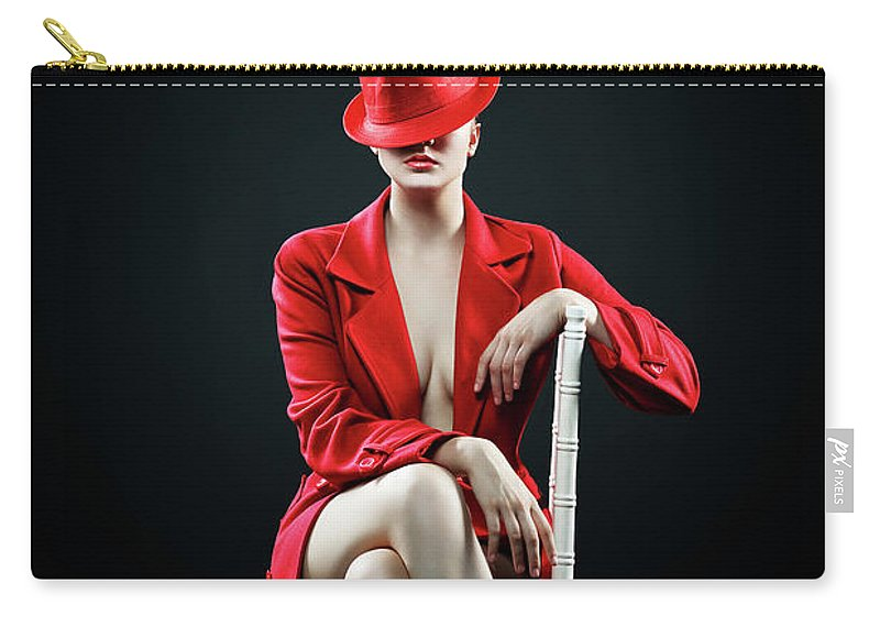 Woman Carry-all Pouch featuring the photograph Woman in red by Johan Swanepoel