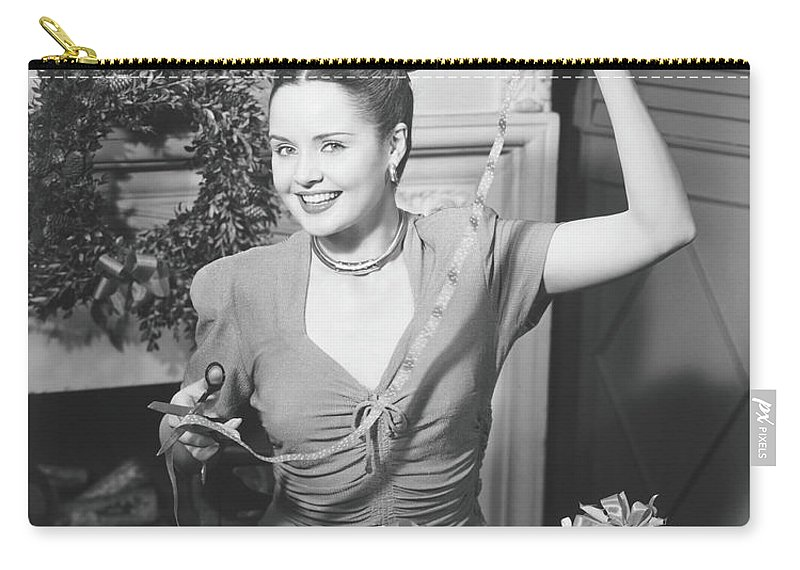 Human Arm Carry-all Pouch featuring the photograph Woman Wrapping Christmas Presents In by George Marks