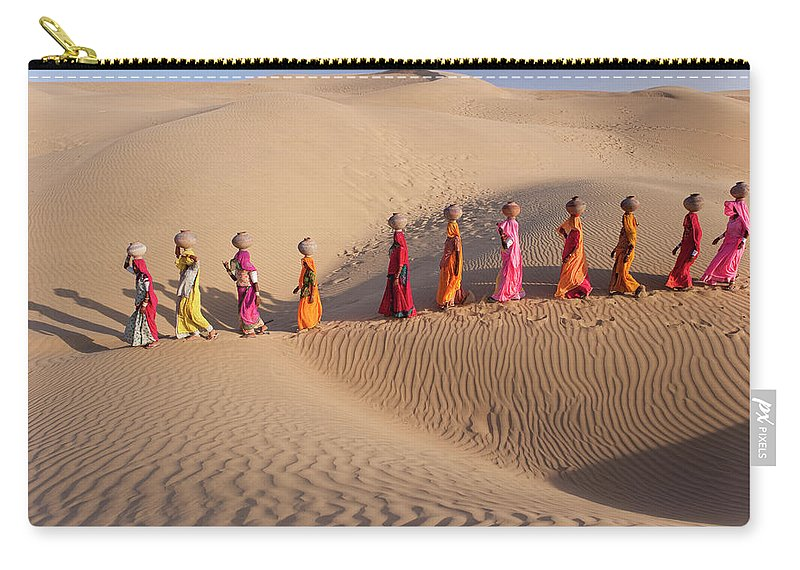 People Carry-all Pouch featuring the photograph Women Fetching Water From The Sparse by Mint Images - Art Wolfe