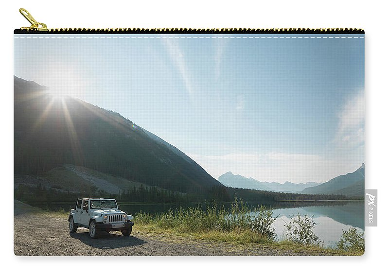 Scenics Carry-all Pouch featuring the photograph Women Pilot Jeep Along Mountain Road by Ascent Xmedia