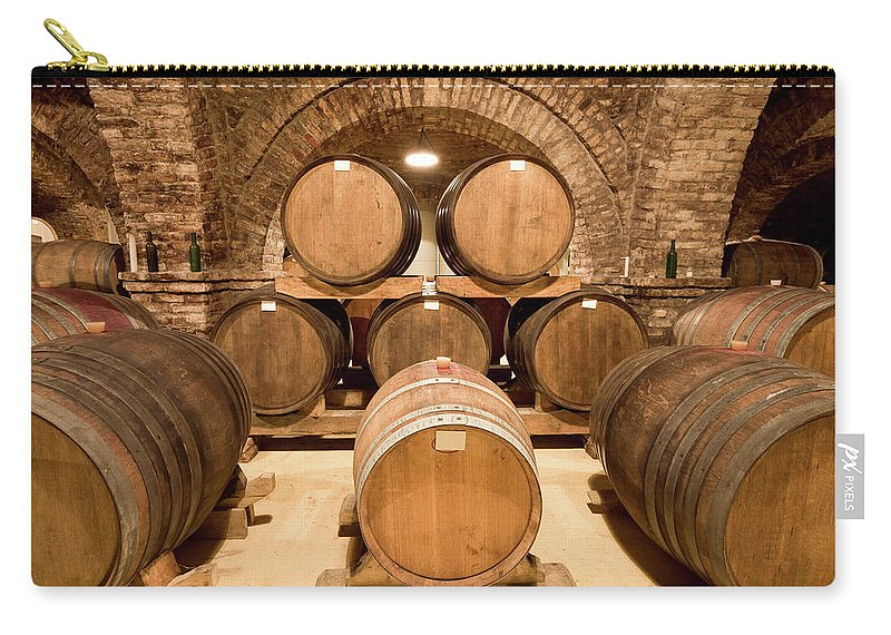 Arch Carry-all Pouch featuring the photograph Wooden Barrels In Wine Cellar by Benedek