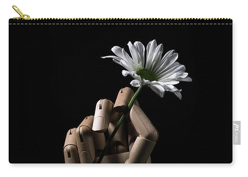 Daisy Carry-all Pouch featuring the photograph Wooden Hand Holding Flower by Edward Fielding