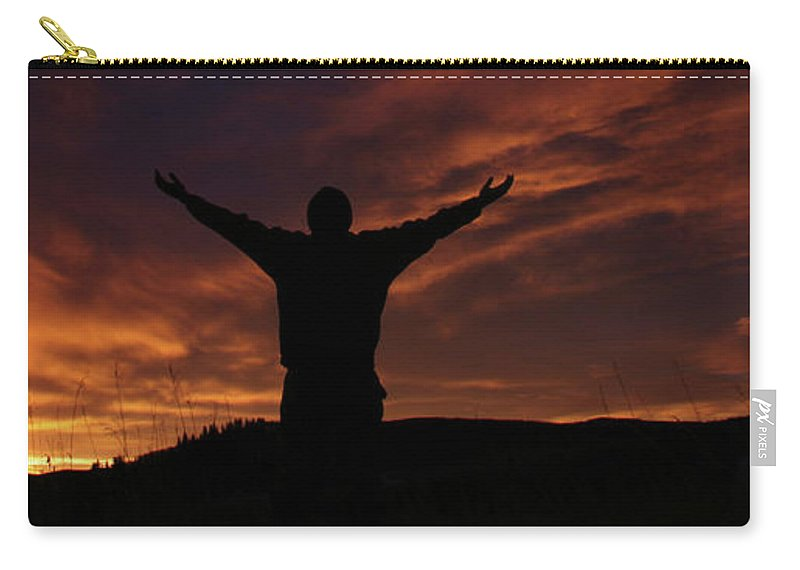 Disbelief Carry-all Pouch featuring the photograph Worship Silhouette by Imaginegolf