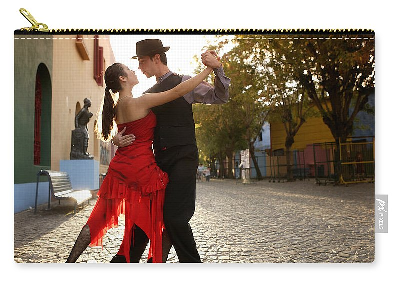 Young Men Carry-all Pouch featuring the photograph Young Couple Dancing Tango In Street by Buena Vista Images