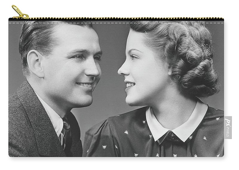 Young Men Carry-all Pouch featuring the photograph Young Couple Looking In Eyes In Studio by George Marks