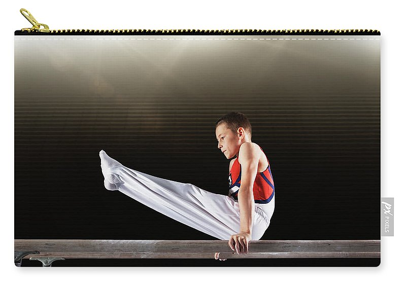 Focus Carry-all Pouch featuring the photograph Young Male Gymnast Performing On by Robert Decelis Ltd