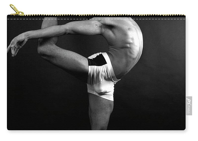 Human Arm Carry-all Pouch featuring the photograph Young Male In Dancer Pose by Michael Rowe