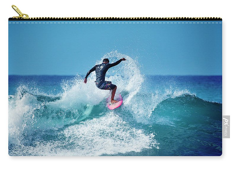 Young Men Carry-all Pouch featuring the photograph Young Male Surfer Surfing In The Water by Yinyang