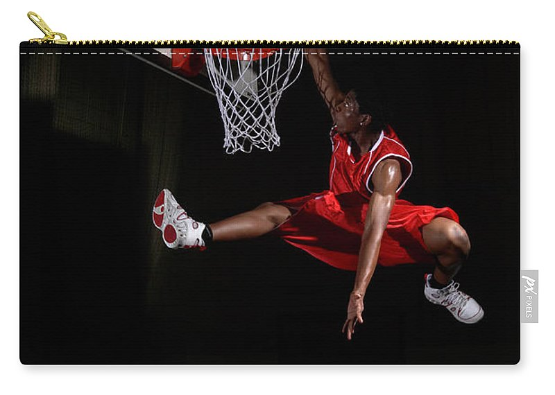 Human Arm Carry-all Pouch featuring the photograph Young Man Making A Fancy Dunk by Compassionate Eye Foundation/steve Coleman/ojo Images Ltd