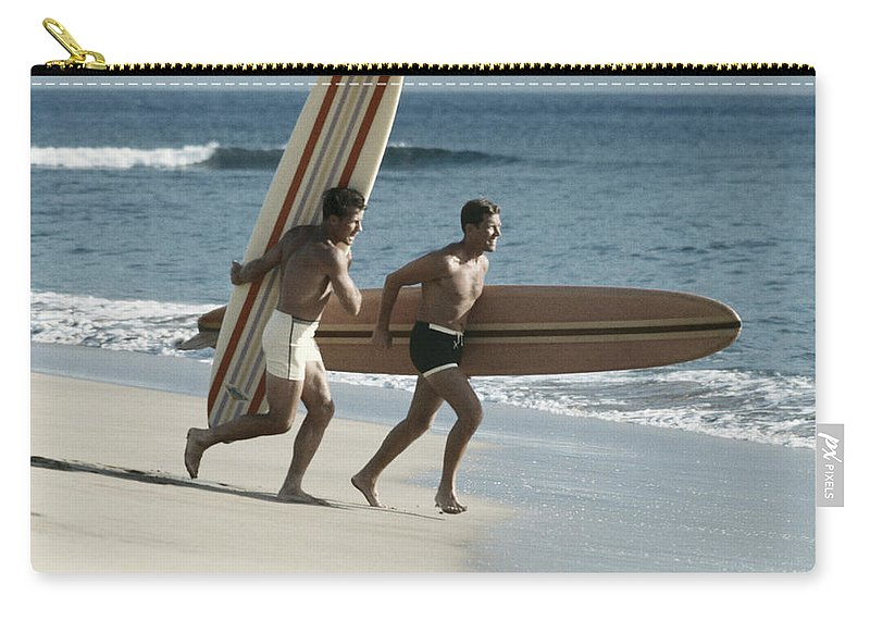 People Carry-all Pouch featuring the photograph Young Men Running On Beach With by Tom Kelley Archive