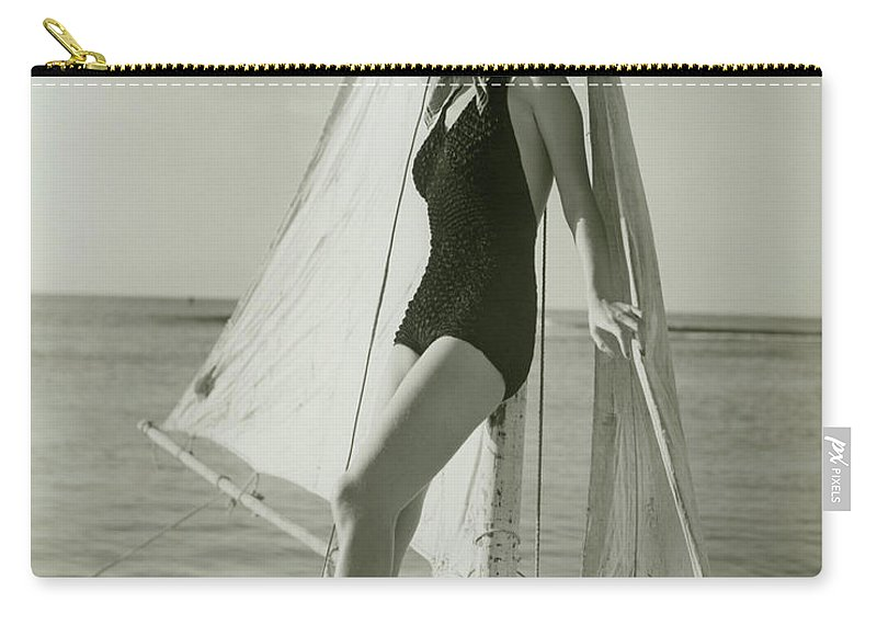 Human Arm Carry-all Pouch featuring the photograph Young Woman Posing On Sailboat by George Marks