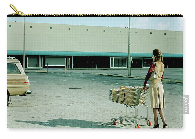 Casual Clothing Carry-all Pouch featuring the photograph Young Woman Pushing Trolly Full Of by Kelvin Murray