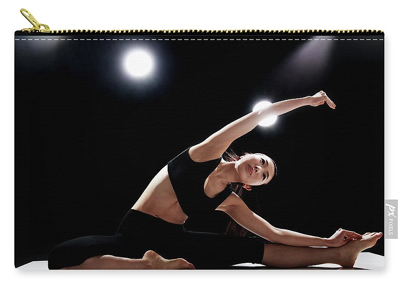 People Carry-all Pouch featuring the photograph Young Woman Stretching by Runphoto