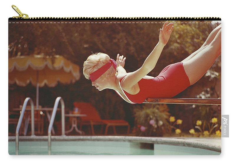 Human Arm Carry-all Pouch featuring the photograph Young Woman With Blindfold Balancing On by Tom Kelley Archive