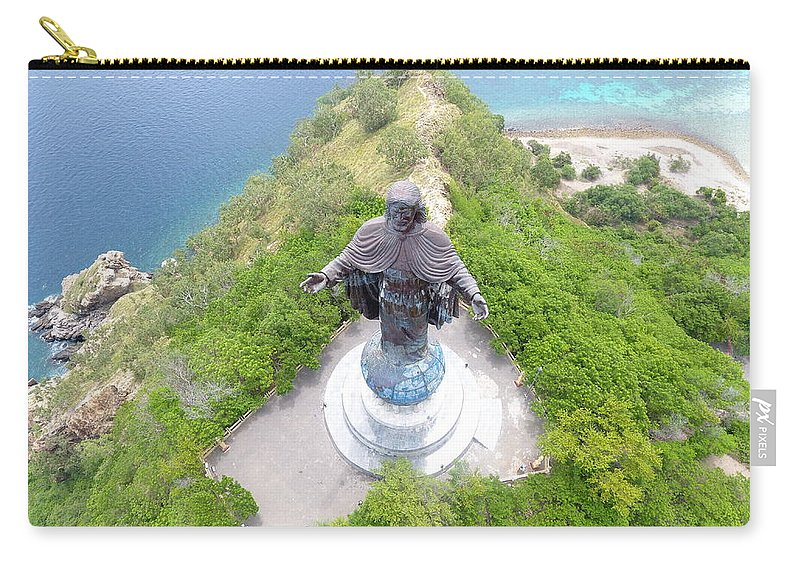 Travel Carry-all Pouch featuring the photograph Cristo Rei of Dili statue of Jesus by Brthrjhn2099