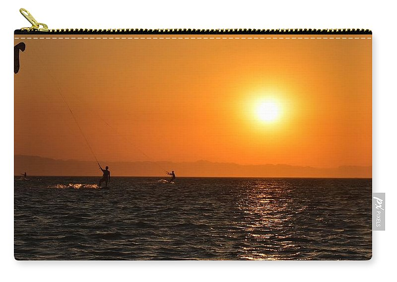 Kitesurfing Carry-all Pouch featuring the photograph Red sea sunset by Luca Lautenschlaeger