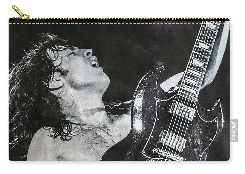 Angus Young Carry-all Pouch featuring the photograph Angus Young 1981 ACDC by Leigh Henningham