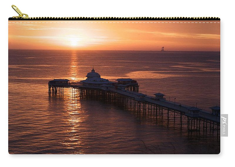 Piers Carry-all Pouch featuring the photograph Sunrise over Llandudno pier 2 by Christopher Rowlands