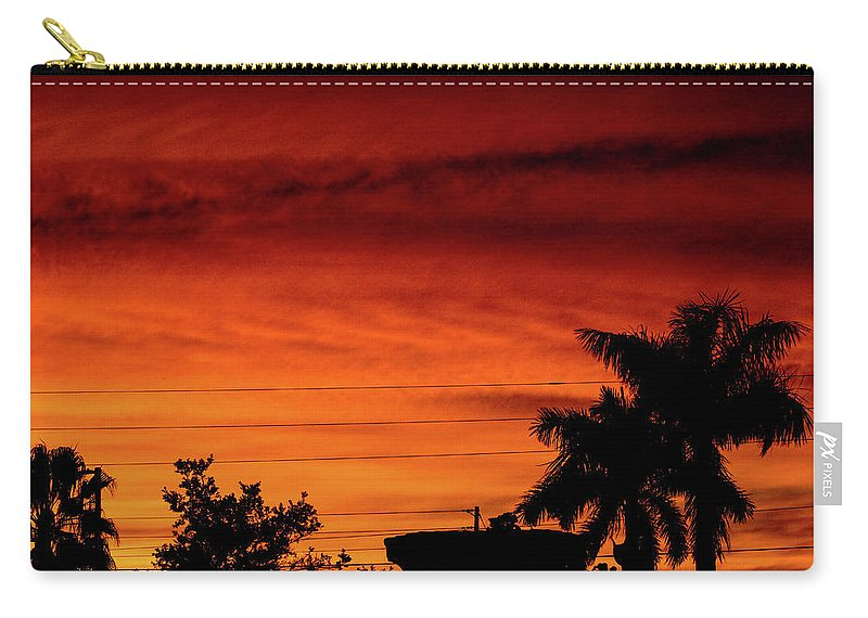 Sunset Carry-all Pouch featuring the photograph The Fire sky by Daniel Cornell
