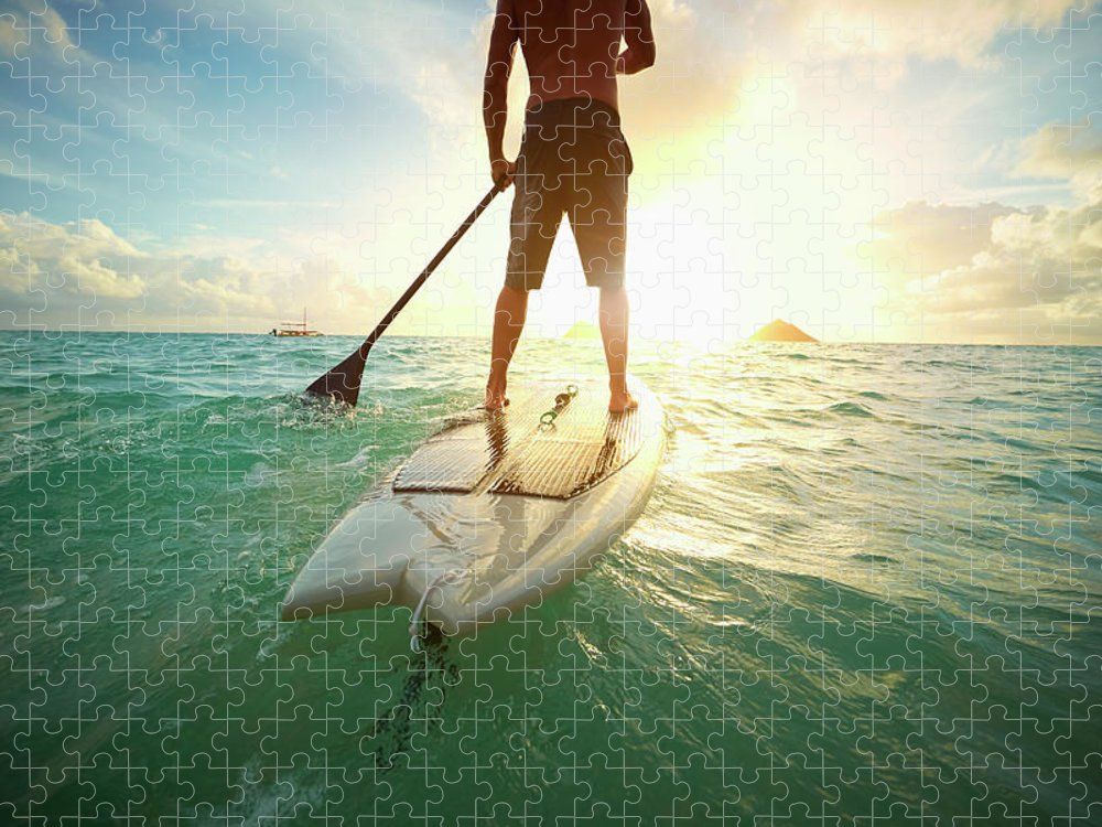 Tranquility Puzzle featuring the photograph Caucasian Man On Paddle Board In Ocean by Colin Anderson Productions Pty Ltd