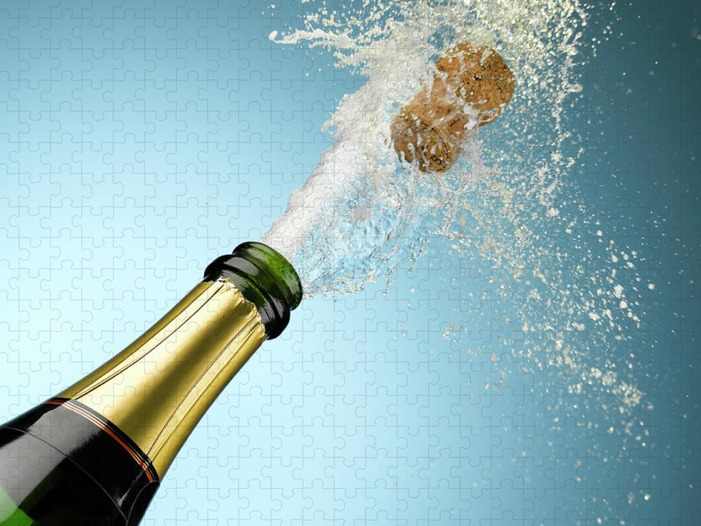 Celebration Puzzle featuring the photograph Champagne And Cork Exploding From Bottle by Andy Roberts