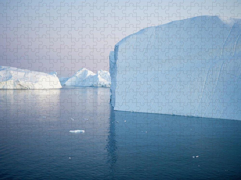 Melting Puzzle featuring the photograph Icebergs Of Ilulissat Kangerlua by Holger Leue