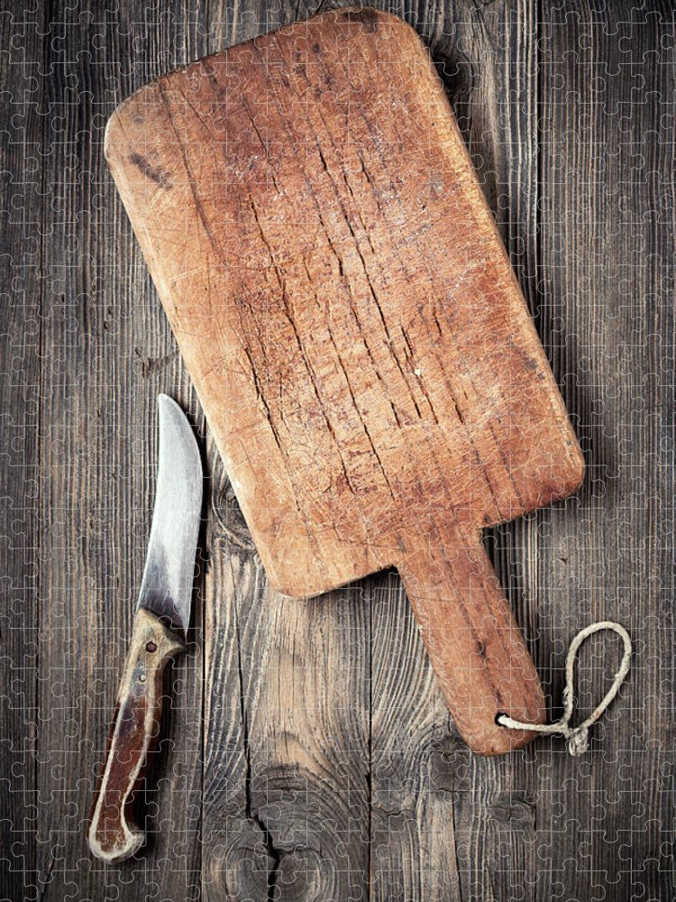 Empty Puzzle featuring the photograph Old Cutting Board And Knife by Barcin