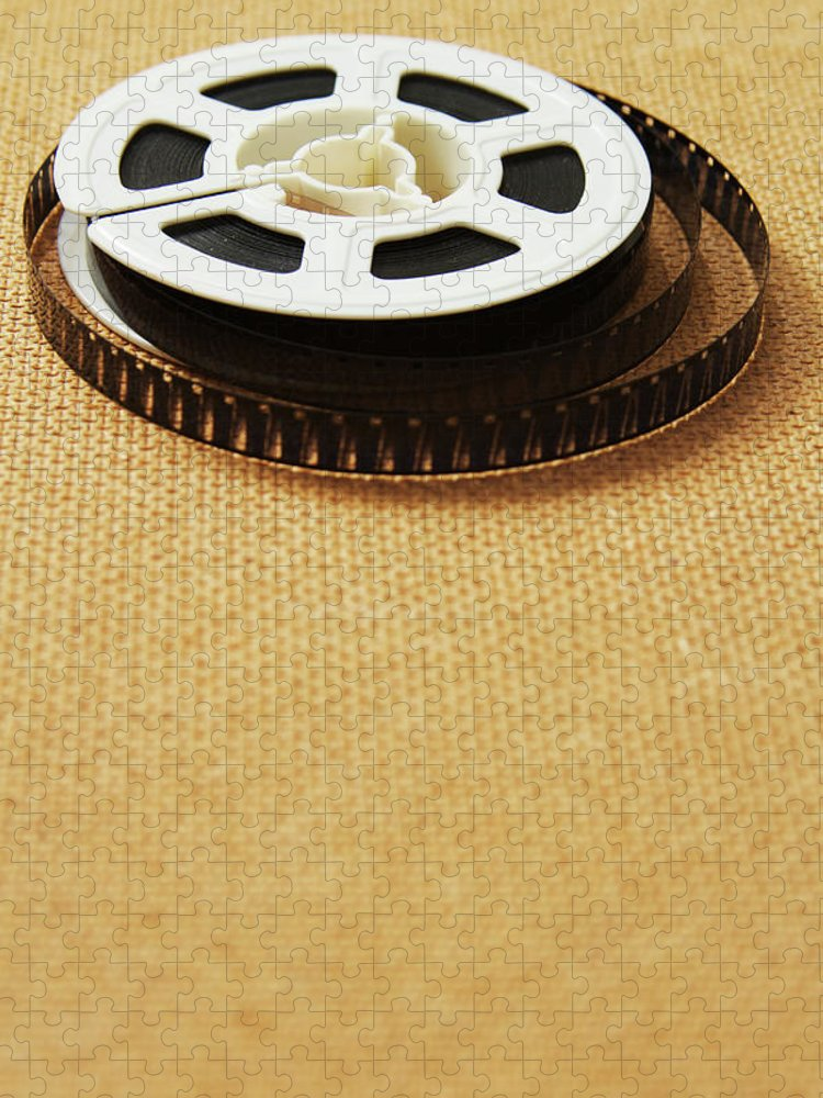 The Media Puzzle featuring the photograph A Reel, Or Spool, Of 8mm Movie Film by Jon Schulte