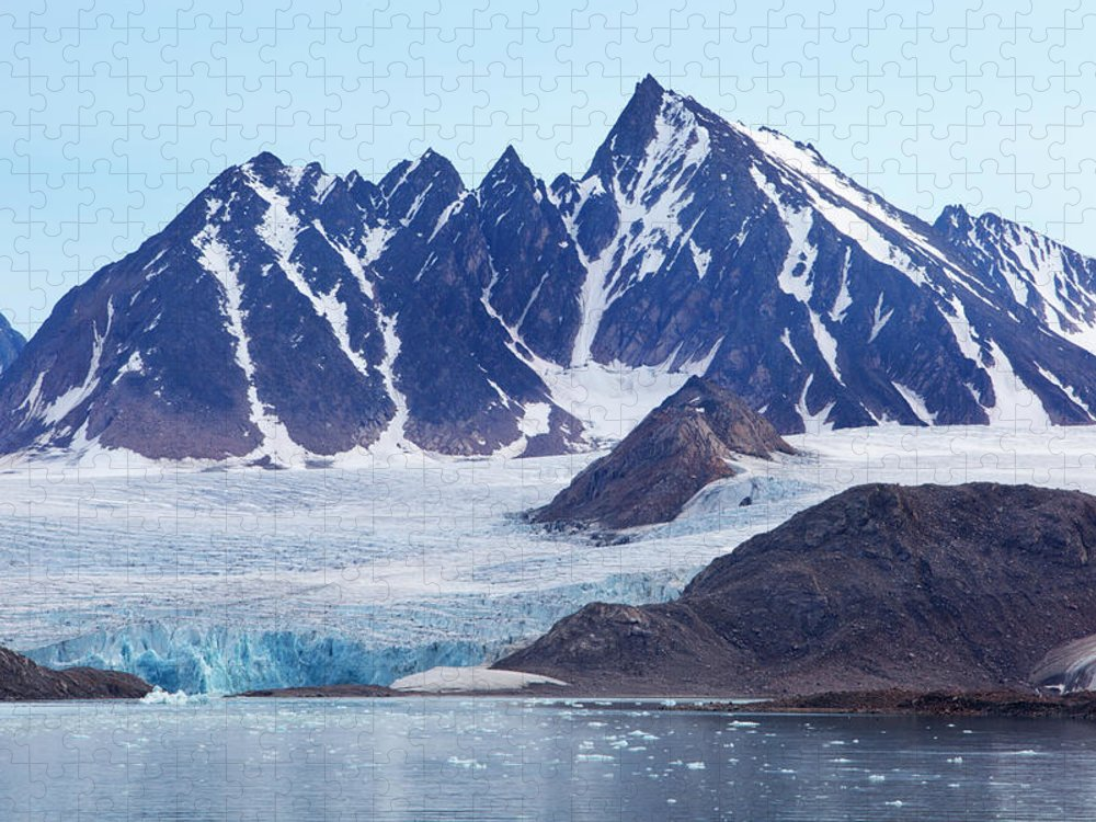 Scenics Puzzle featuring the photograph Glaciers Tumble Into The Sea In The by Anna Henly