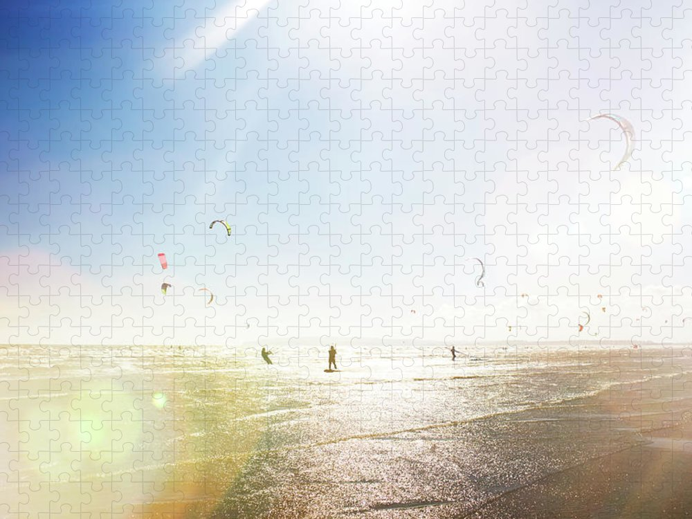 Water's Edge Puzzle featuring the photograph Kite Surfers by Nick David