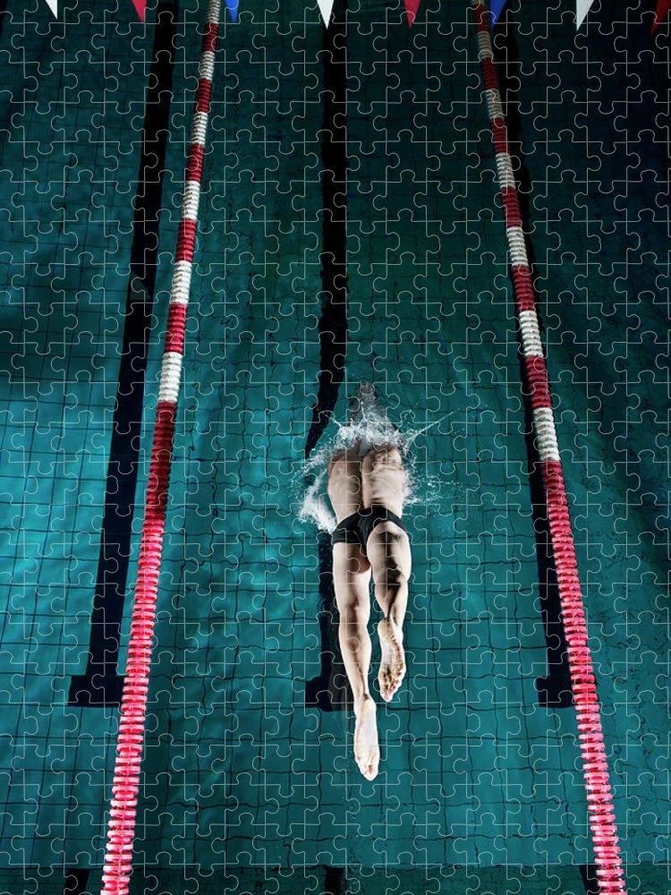 Copenhagen Puzzle featuring the photograph Professional Swimmer by Henrik Sorensen