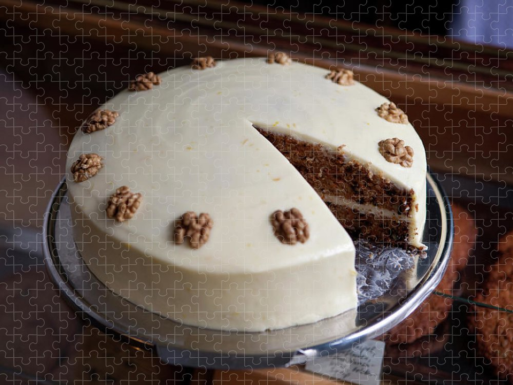 Unhealthy Eating Puzzle featuring the photograph A Carrot Cake On A Display Cabinet In A by Halfdark