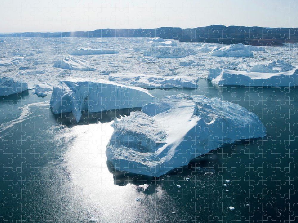 Melting Puzzle featuring the photograph Aerial Of Icebergs Of Ilulissat by Holger Leue