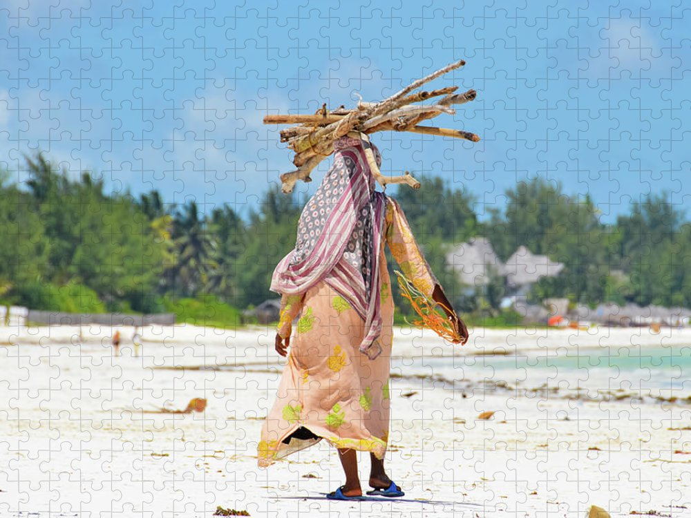 People Puzzle featuring the photograph African Girl With A Bundle Of Reeds On by Volanthevist