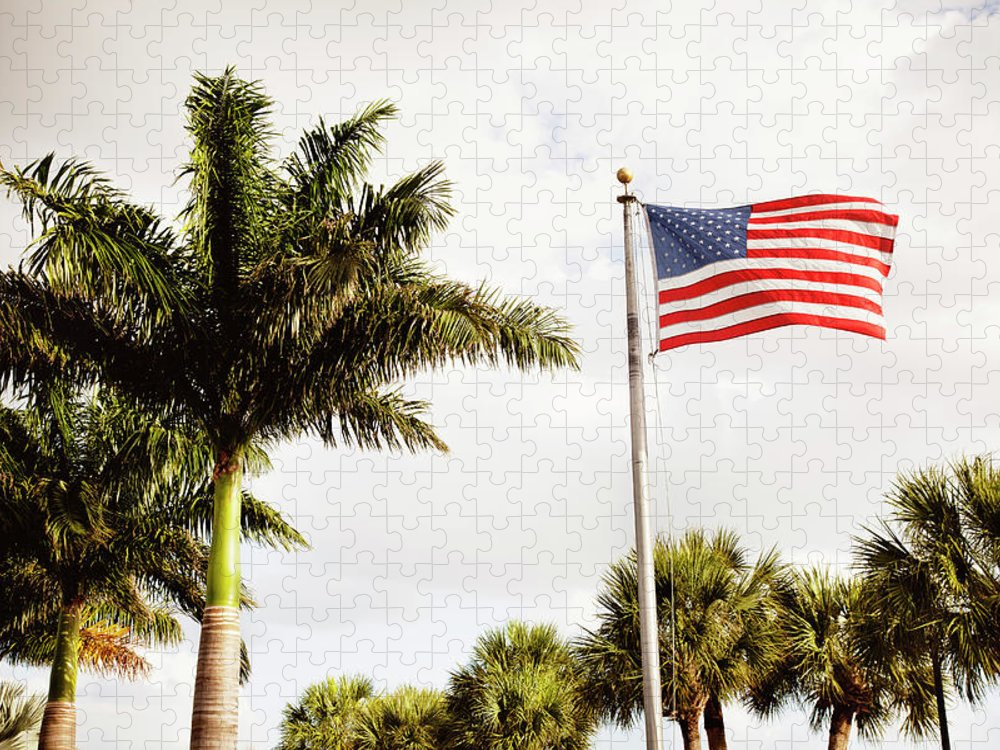 Tranquility Puzzle featuring the photograph American Flag Flying Amongst Palm Trees by Ron Levine