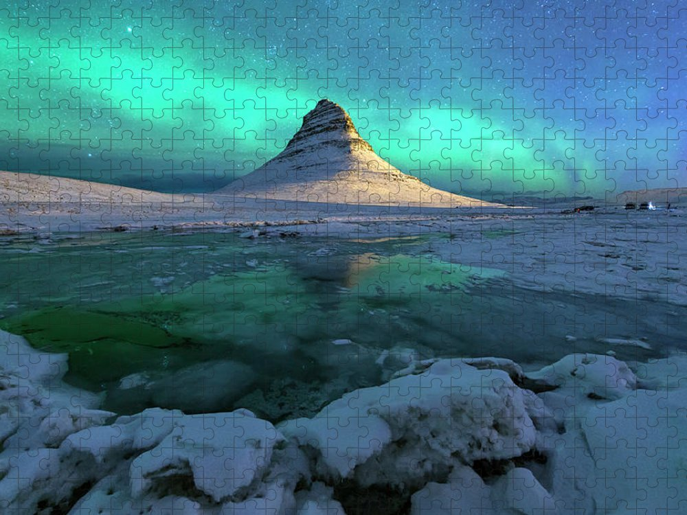 Tranquility Puzzle featuring the photograph Aurora Over Kirkjufell Mountain Iceland by Ratnakorn Piyasirisorost