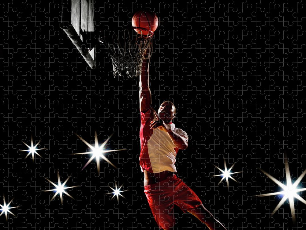 Three Quarter Length Puzzle featuring the photograph Basketball Player Dunking Basketball On by Compassionate Eye Foundation/chris Newton