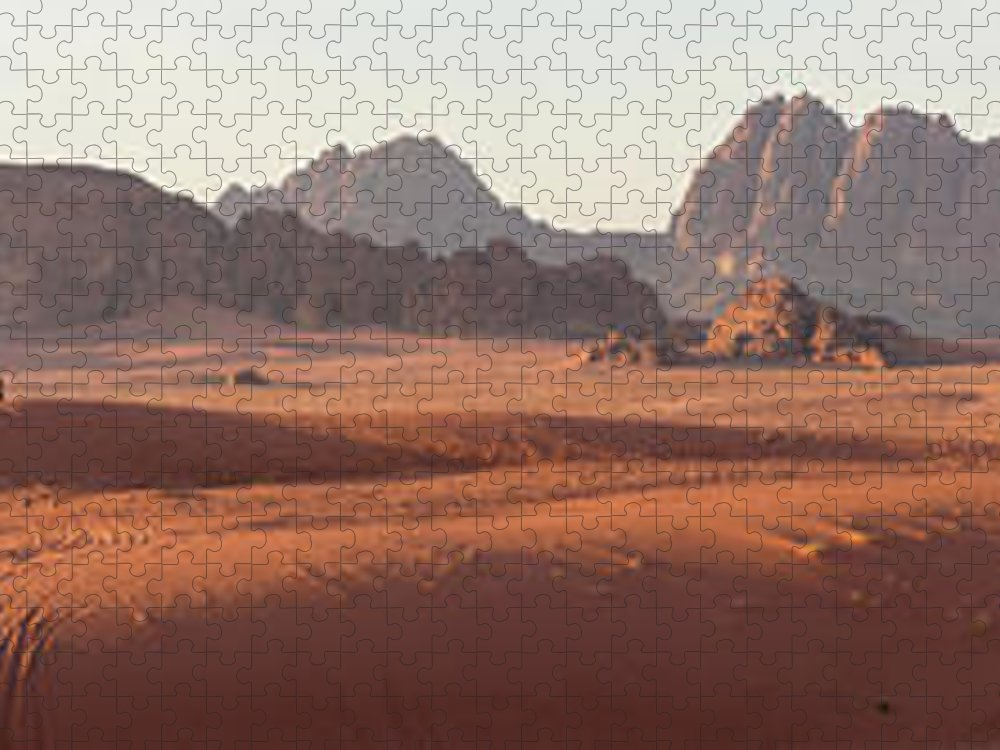 Scenics Puzzle featuring the photograph Bedouin Man Walking Across Wadi Rum by Peter Adams