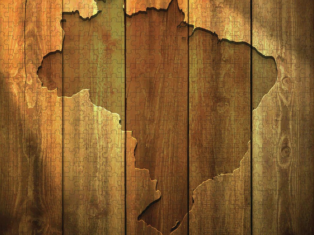 Material Puzzle featuring the digital art Brazil Map On Lit Wooden Background by Bgblue
