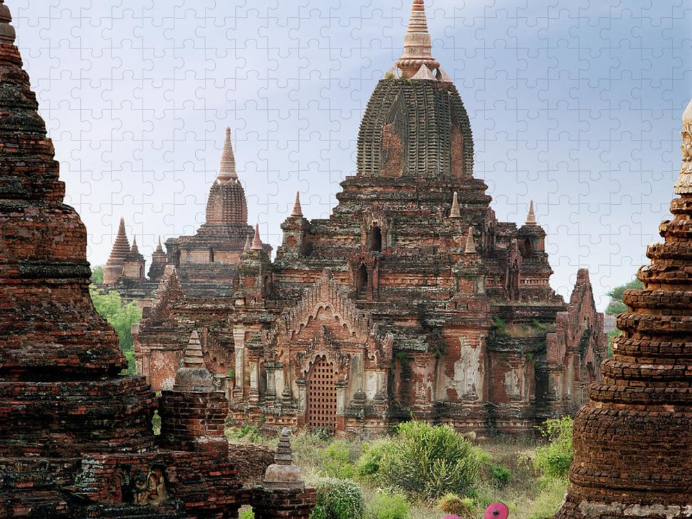 Tranquility Puzzle featuring the photograph Buddhist Monks Walking Past Temple by Martin Puddy