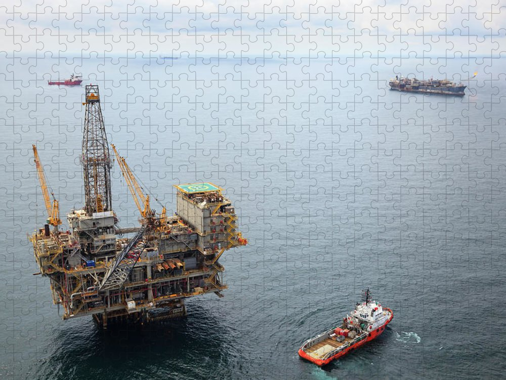 Oil Rig Supply Ship Puzzle featuring the photograph Busy Oil Field by Heliry