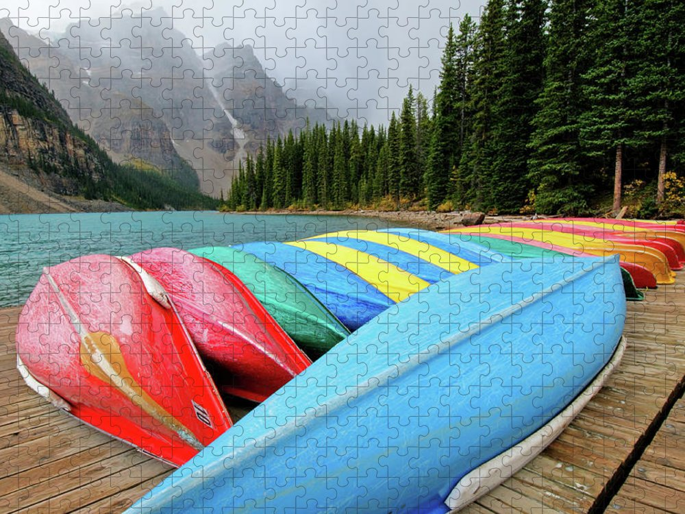 Scenics Puzzle featuring the photograph Canoes Line Dock At Moraine Lake, Banff by Wildroze
